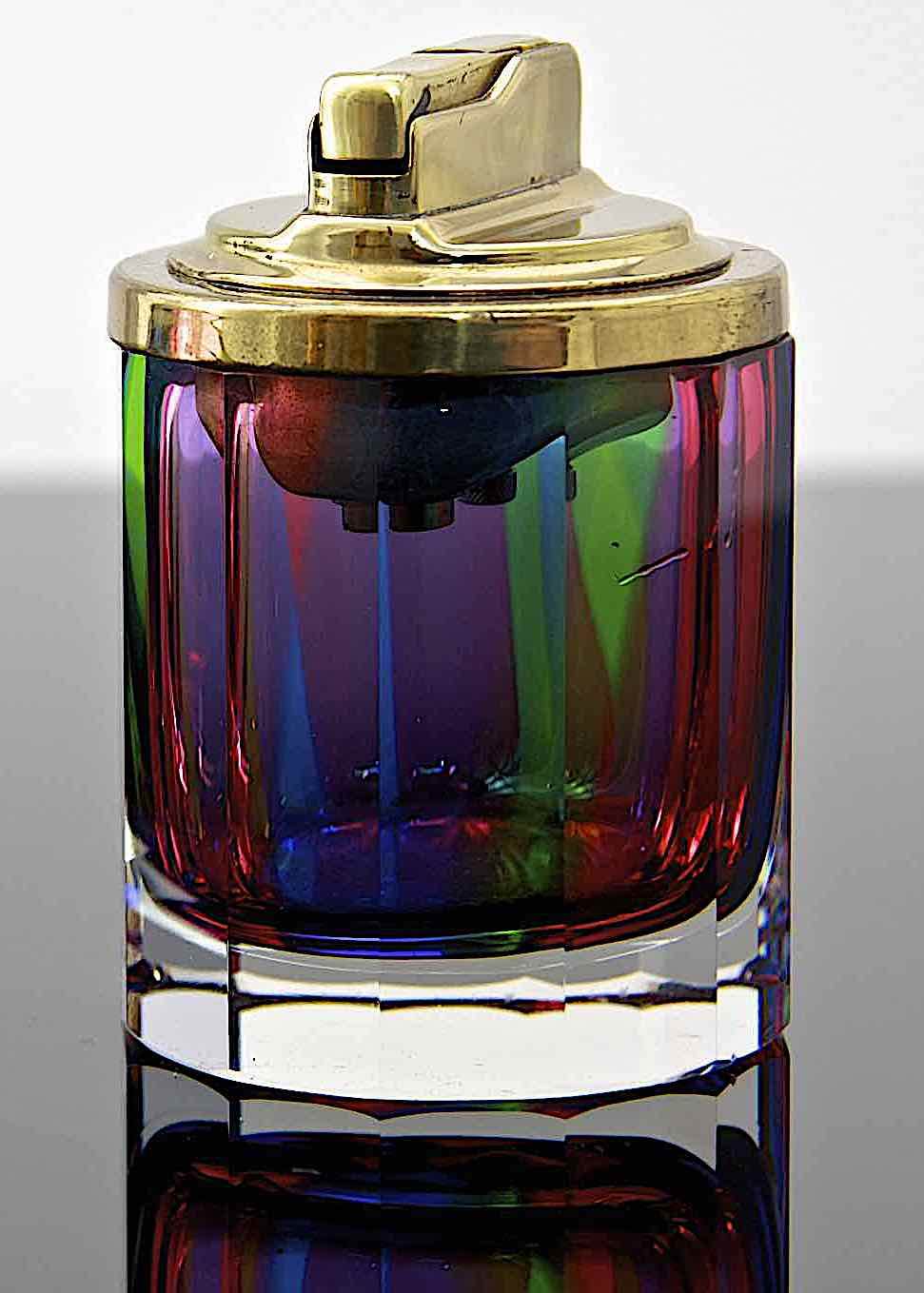 a 1970s glass cigarette lighter by Murano in a color photograph