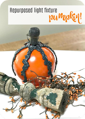 Fall pumpkin made with repurposed lamp parts