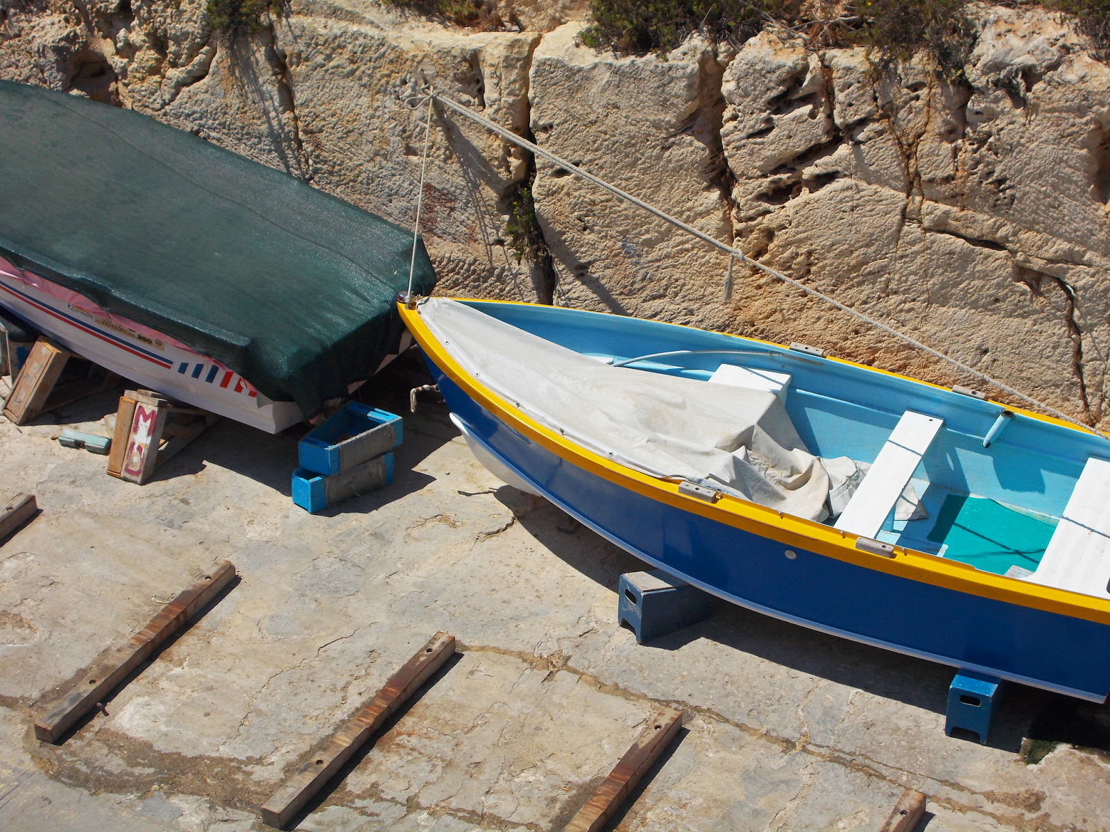Rustic boats leading to the waters of the Blue Lagoon in Malta
