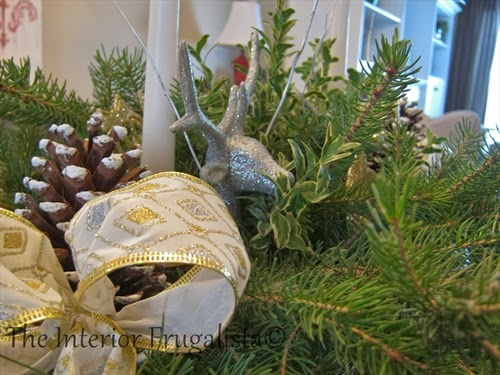 Wired ribbon, pine cones, and ornaments used in pallet board centerpiece