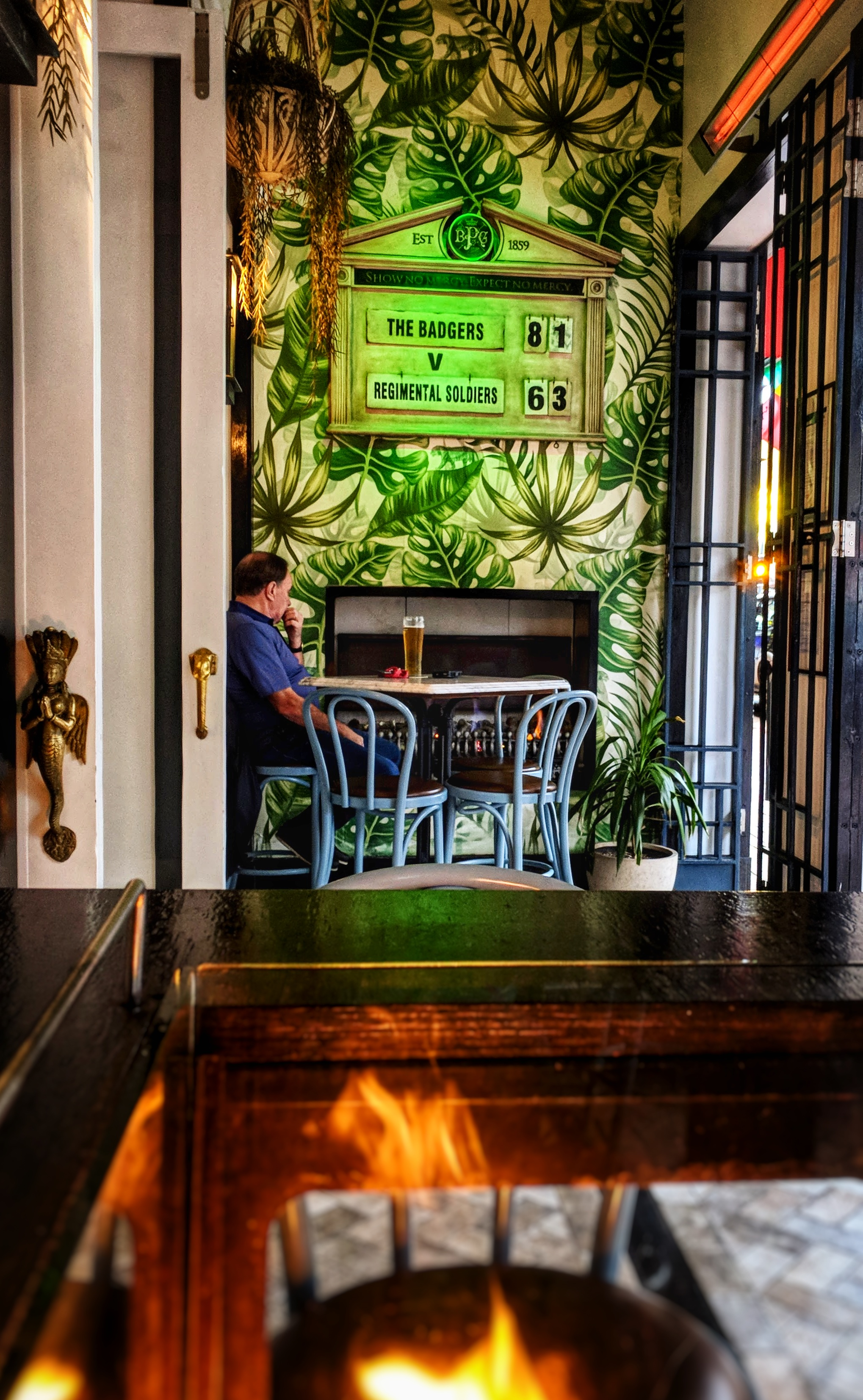 Entrance to bar with man pondering
