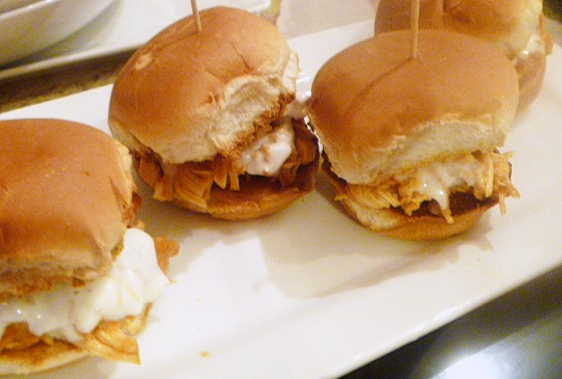 Game Day Eats:  Buffalo Chicken Sliders - Chicken breasts cooked in a buffalo sauce mixture in the slow cooker, to create some succulent filing for your sandwiches. - slice of southern