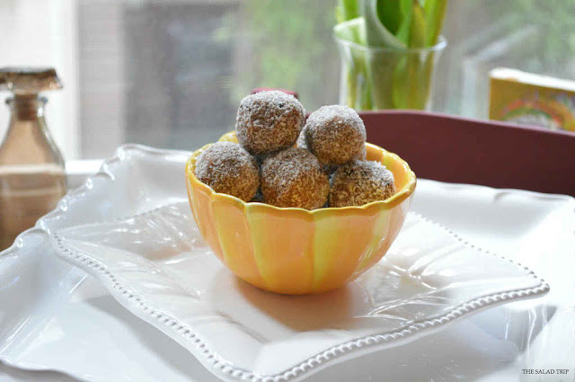 Coconut Chocolate Peanut Butter Protein Balls in a floral bowl by a window