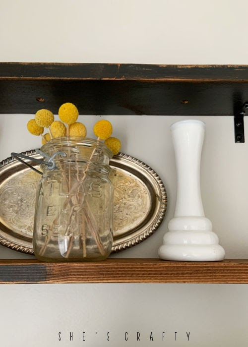 Use vintage mason jars and metal platters to decorate reclaimed wood shelves.