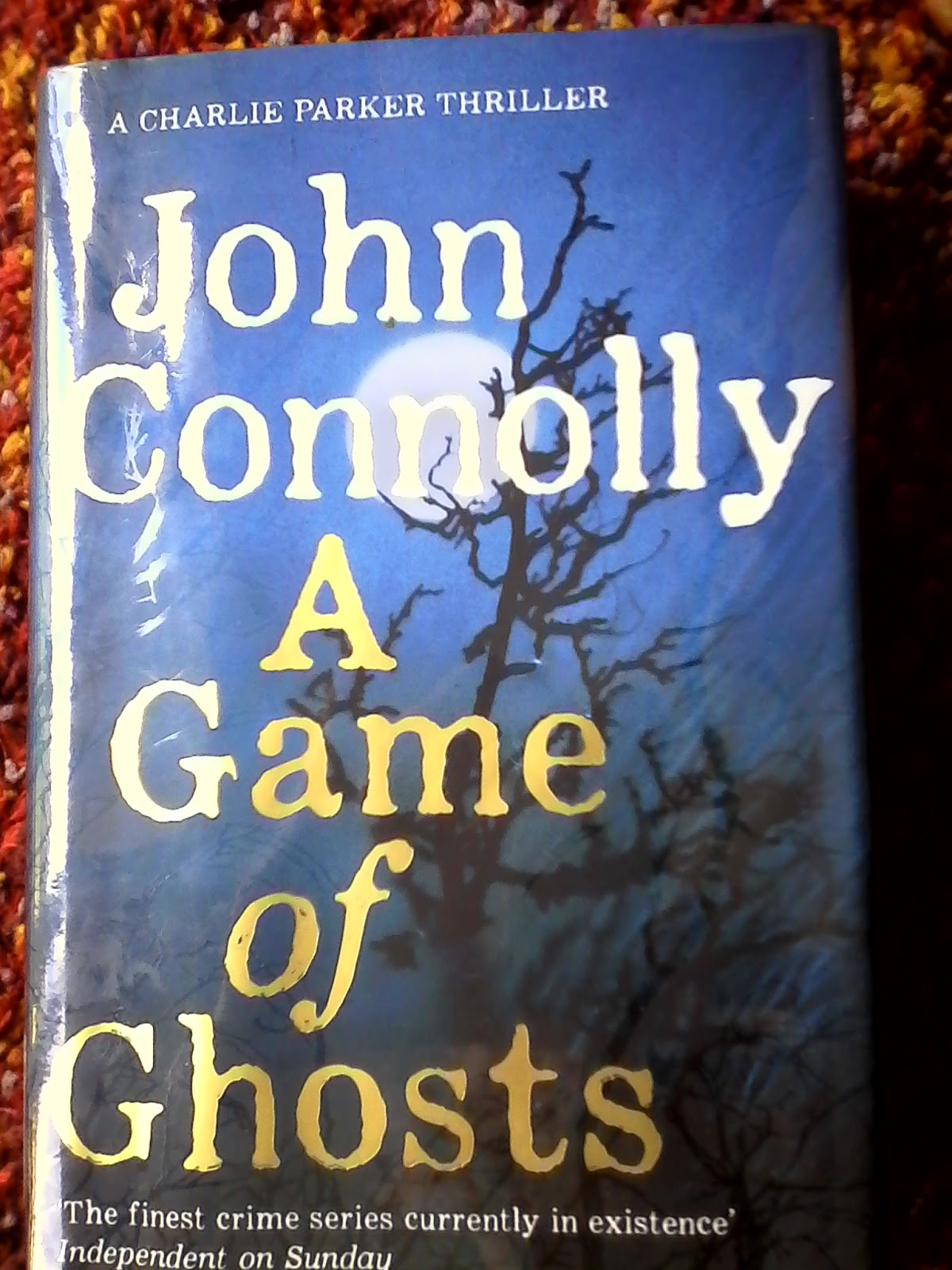 """Even though """"A Game of Ghosts"""" is the fifteenth Charlie Parker novel,  Connolly's thriller is as compelling and intriguing as ever."""