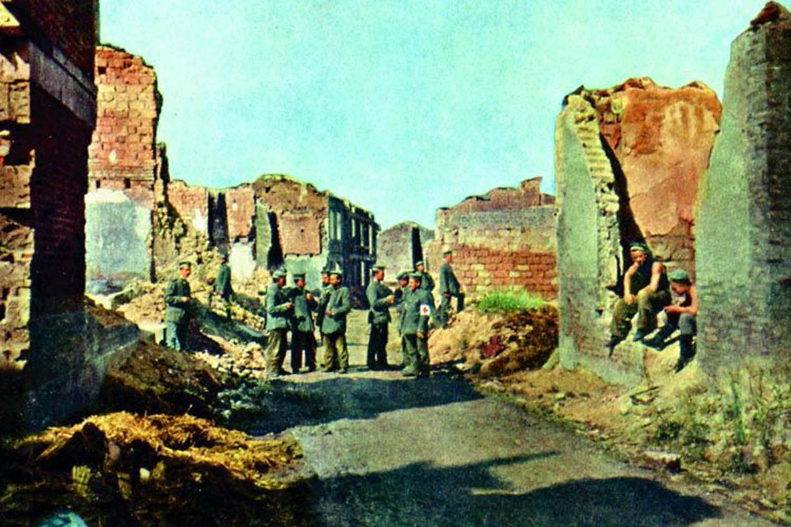 A group of German soliders stand in the ruins of Sommepy, a French village on the river Marne.