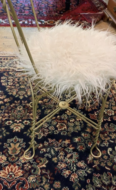 Redone ice cream parlor chair with gold paint and faux fur seat