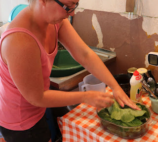 Putting cabbage leaves into the steamer