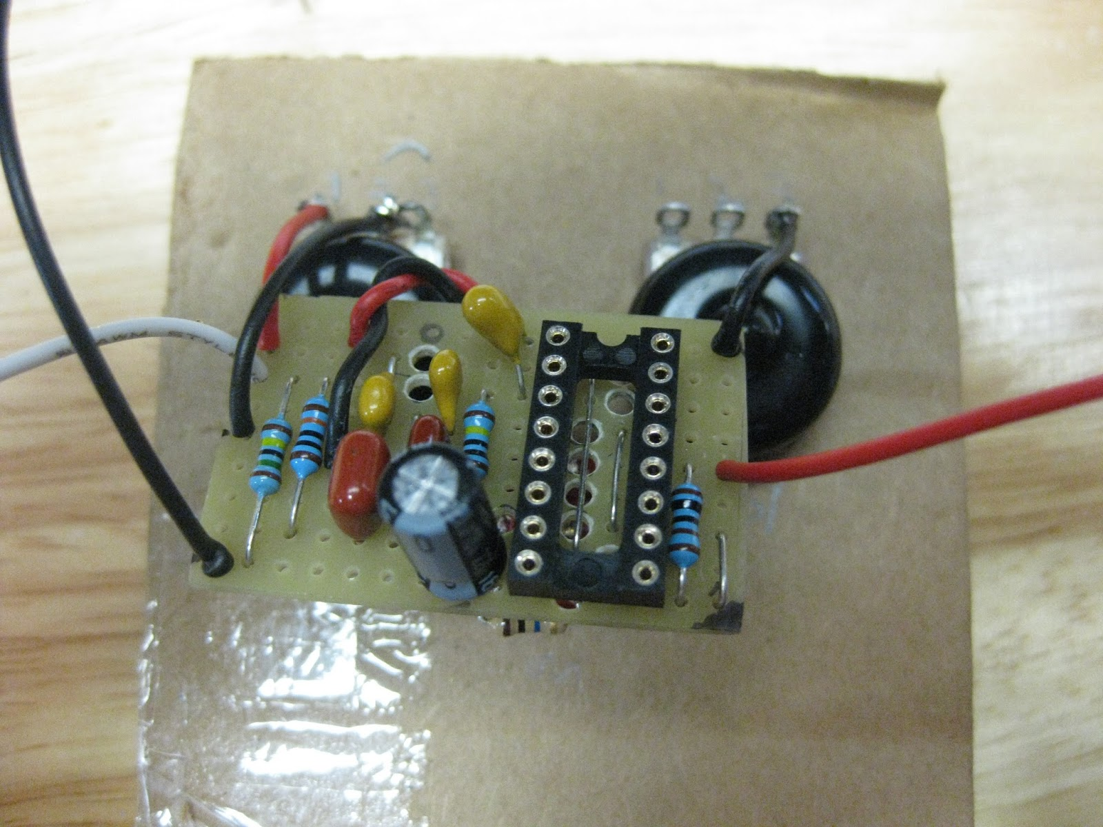 diy guitar pedal projects red llama with mods is being soldered. Black Bedroom Furniture Sets. Home Design Ideas