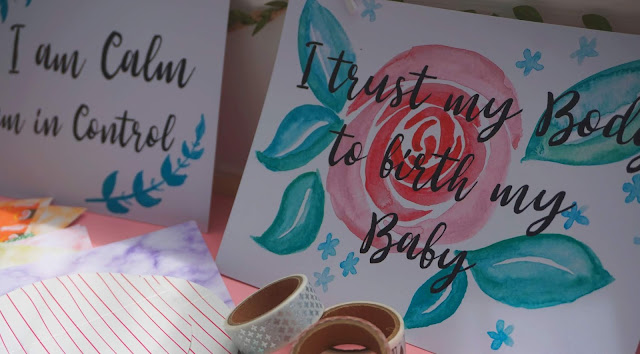 image shows a birth affirmation card and range of arts and crafts objects