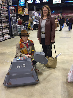 Photo of me standing with a cosplayer dressed as the 4th Doctor, plus the K-9 he crafted.