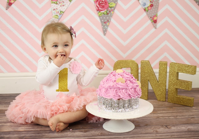 pink and gold cake smash photos