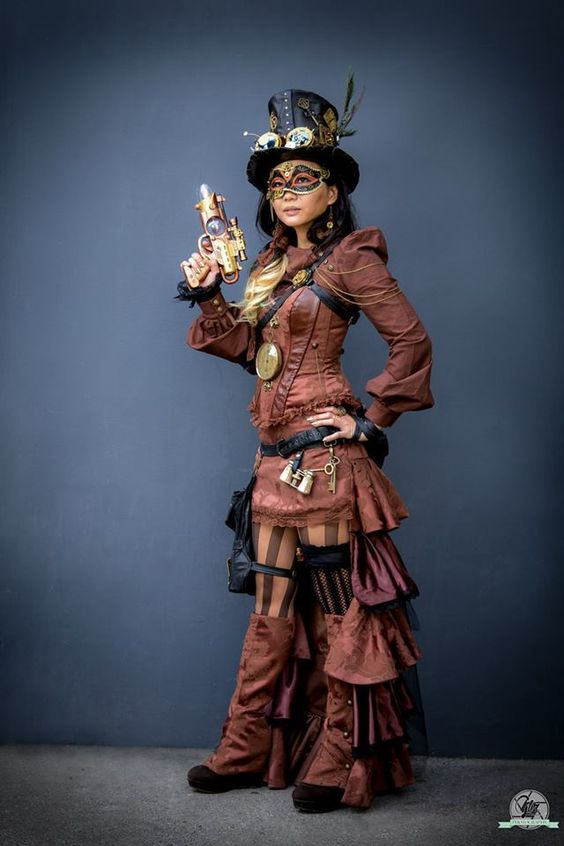 Women's steampunk clothing and costumes in brown with black leather and gold accessories, mask and jewelry