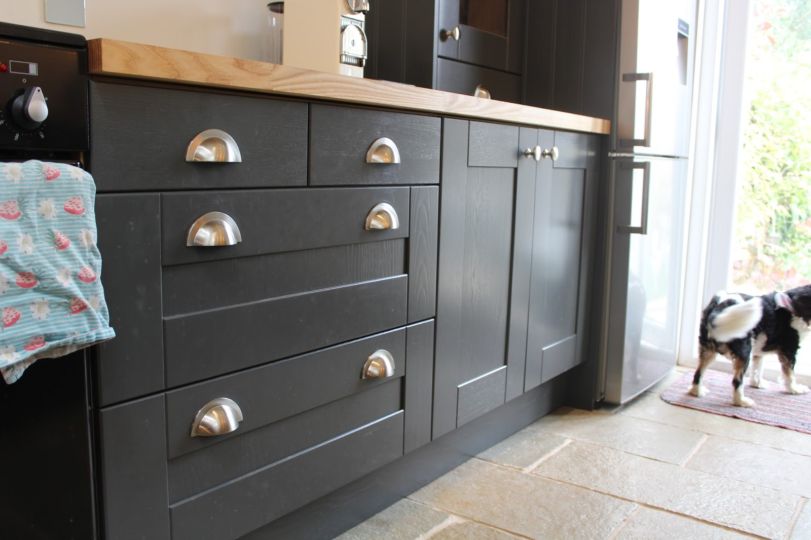 satin nickel drawer handles in graphite kitchen