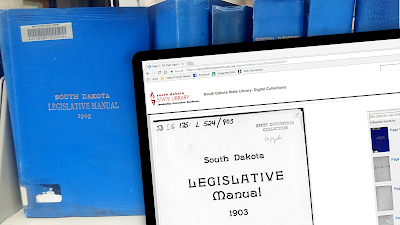 Book shelf with 1903 South Dakota Legislative Manual with tablet screen of web page with same book in digital format