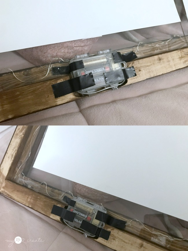 attaching the LED lights to the picture frame