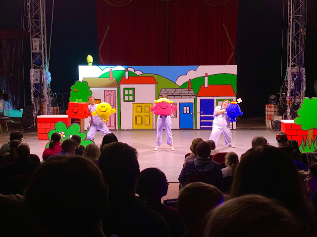 View to a stage with mr men puppets being moved by actors in the Winter Wonderland MegaDome