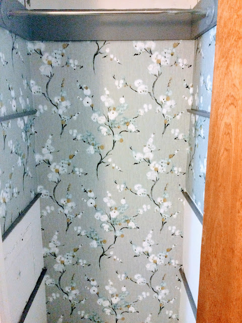 how to progress in wallpapering a wall