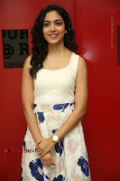 Actress Ritu Varma Stills in White Floral Short Dress at Kesava Movie Success Meet .COM 0040.JPG