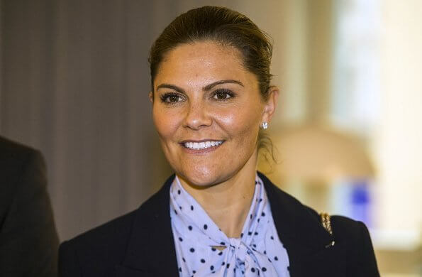 Crown Princess Victoria is wearing Af Klingberg boots, Tiger of Sweden Molena blazer, Valentino shoulder bag, polka dot blue silk blouse