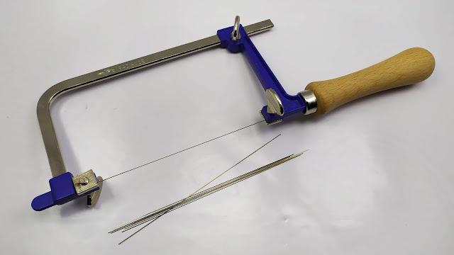 منشار يدوي و شفرات لتقطيع الاشياء الدقيقة  - Adjustable Hand Saw Frame Saw Bow for wood & Metal