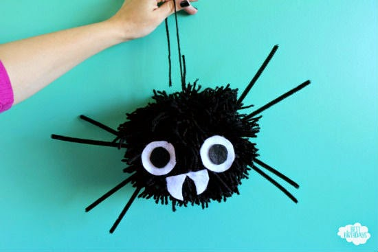 How to Make Giant Pom Pom Spiders for Halloween: there's a secret trick that makes them SUPER quick and easy!