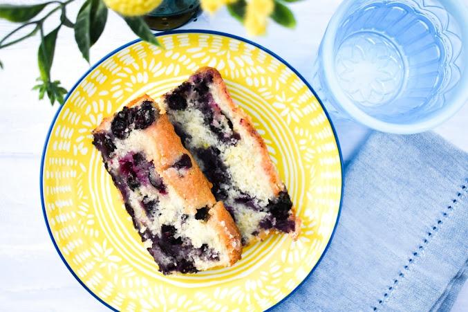 Slices of soft, moist and fruity vegan blueberry and lemon cake