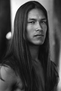 native man with long hair