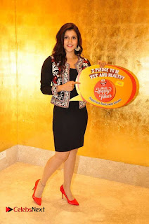 Actress Mannara Chopra Pictures in Short Dress Happy Times Campaign Launch at Radio Mirchi  0005