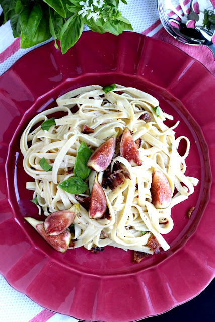 linguini pasta topped with fresh figs and basil