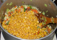 Mixing sweet corn with Nigerian fried rice