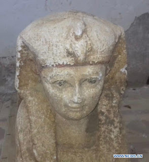 a small royal statue of a Sphinx in Minya province, Egypt.