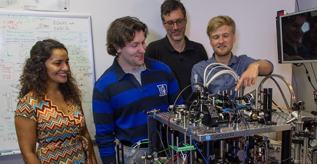 Members of the Cold Atom Laboratory team at NASA's Jet Propulsion Laboratory are seen here with their ground-based testbed, which can reliably create a Bose-Einstein condensate. Pictured from left to right, Anita Sengupta, Ethan Elliott, Rob Thompson and Markus Krutzik. Image Credit: NASA/JPL-Caltech