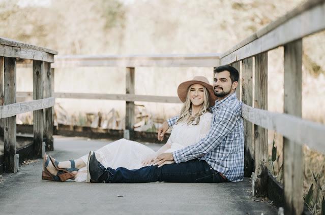 couple sitting on dock smiling