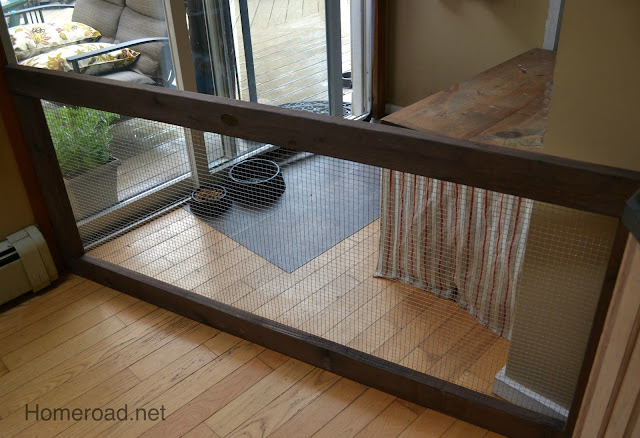 Dog fence in corner with feed bowls