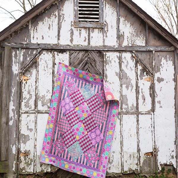 Pastel Perfection quilt pattern designed by Linda Barrett spotlighting Kaffe Fassett Artisan collection for Free Spirit Fabric