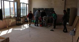 The workmen bring their stuff inside