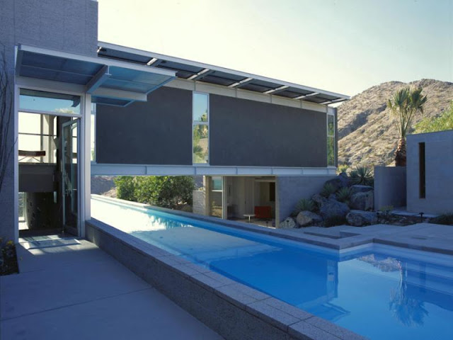 Photo of house and the pool passing below it
