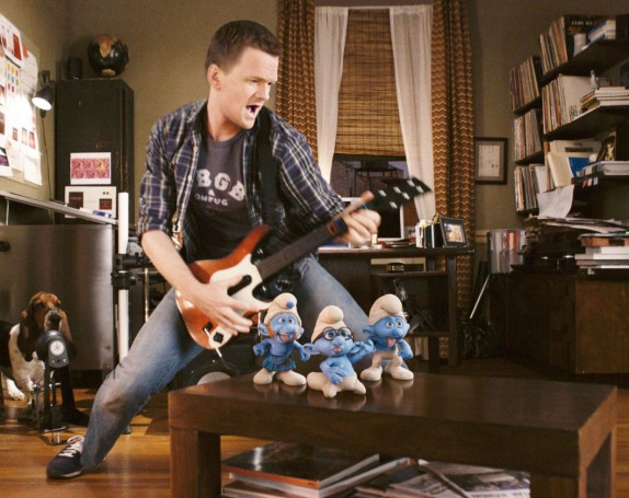 The Smurfs Neil Patrick Harris as Patrick Winslow playing the guitar in The Smurfs
