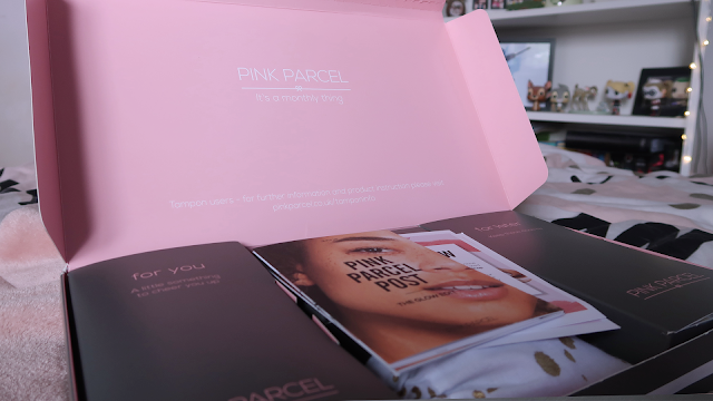 pink parcel open with all boxes inside and leaflets