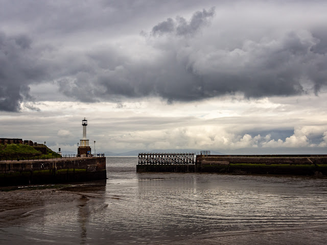 Photo of Maryport lighthouse from across the basin