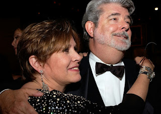 US ctress Carrie Fisher and director  George Lucas pose during the 33rd AFI Life Achievement Award tribute to George Lucas at the Kodak Theatre in Hollywood, California in June 2005