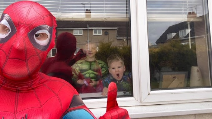 Runner dresses up as Spider-Man during quarantine to make kids smile