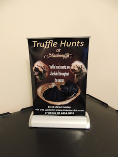 Banner advertising truffle hunts at Macenmist
