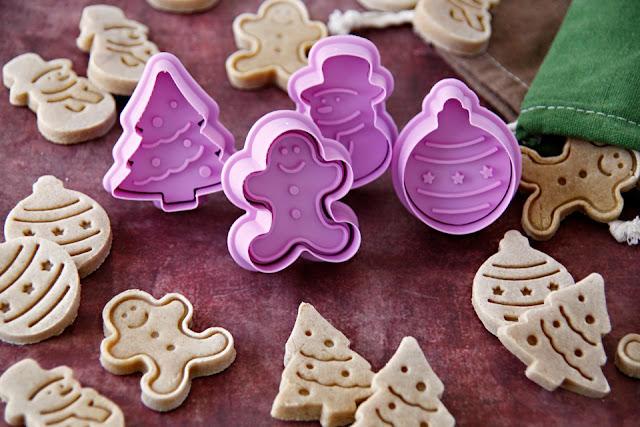 Homemade Christmas dog treats made with holiday plunger cookie cutters