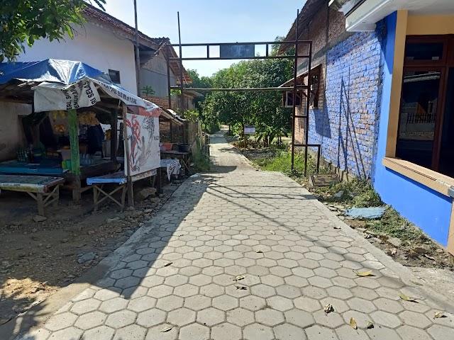 Pembangunan Jalan Paving Totongan