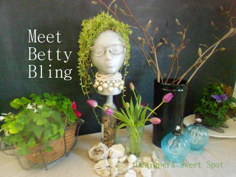 Garden display with garden head @designerssweetspot.com