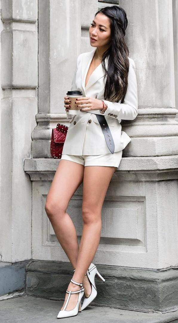 cute office outfit idea / red bag + white blazer + belt + shorts + heels