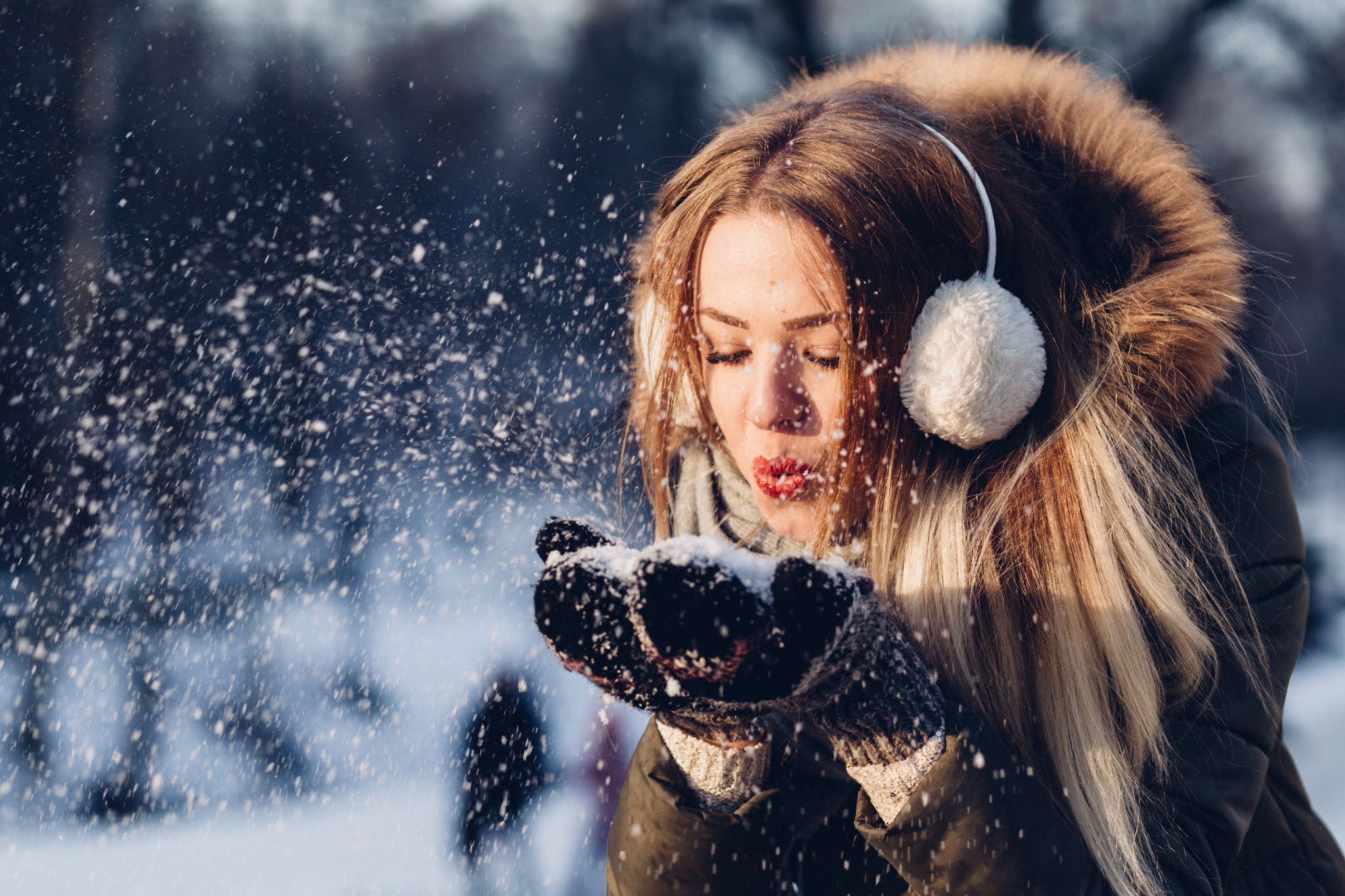 Girl in winter fur outfit  in the snow
