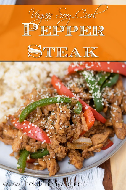 The finished soy curl pepper steak on a plate with rice and the title above.